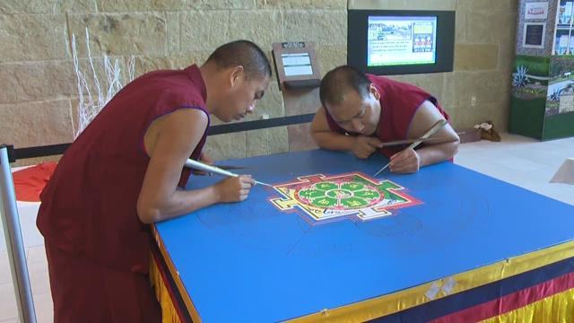 Tibetan Buddhist monks making art at Austin City Hall