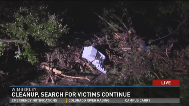 Cleanup, search for flood victims continues
