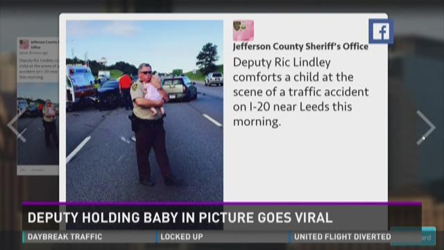 Photo of Alabama deputy holding baby captures of Internet's heart